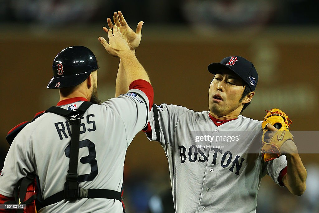 <a gi-track='captionPersonalityLinkClicked' href=/galleries/search?phrase=Koji+Uehara&family=editorial&specificpeople=801278 ng-click='$event.stopPropagation()'>Koji Uehara</a> #19 and <a gi-track='captionPersonalityLinkClicked' href=/galleries/search?phrase=David+Ross+-+Baseball+Player&family=editorial&specificpeople=210843 ng-click='$event.stopPropagation()'>David Ross</a> #3 of the Boston Red Sox celebrate their 4 to 3 win over the Detroit Tigers in Game Five of the American League Championship Series at Comerica Park on October 17, 2013 in Detroit, Michigan.