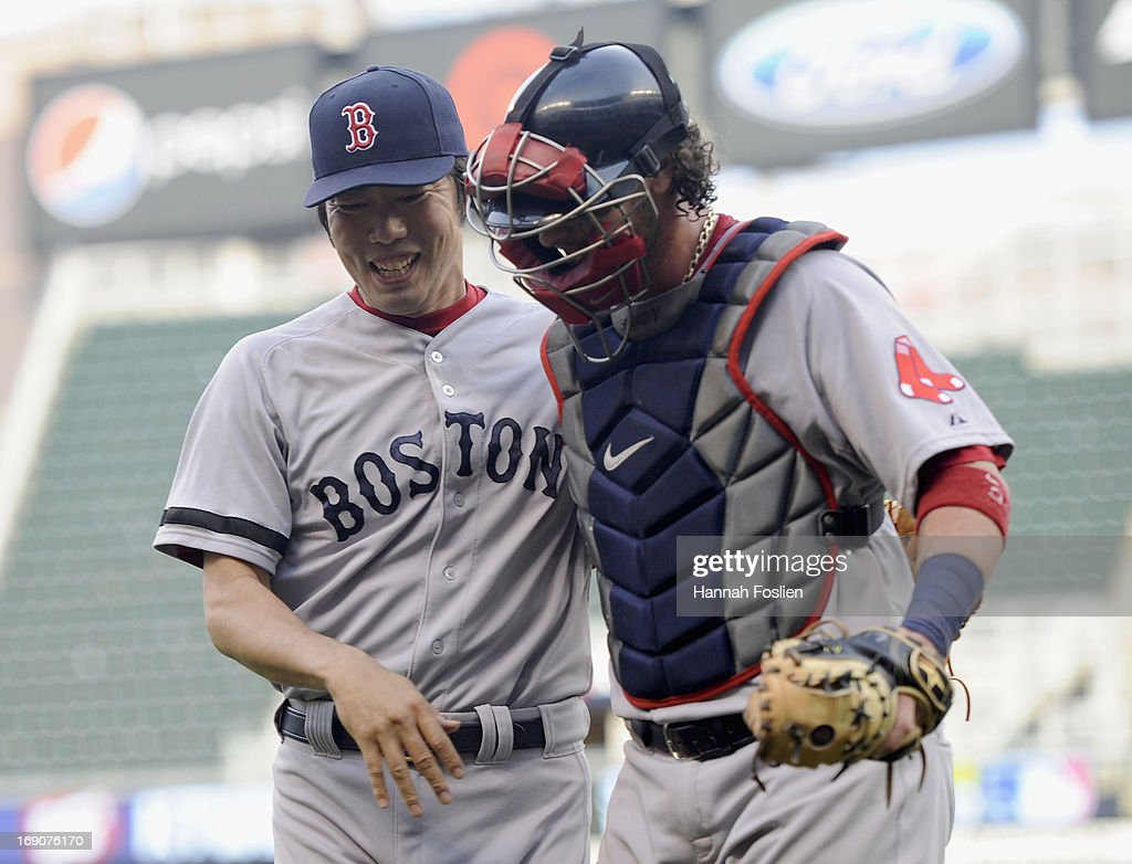 <a gi-track='captionPersonalityLinkClicked' href=/galleries/search?phrase=Koji+Uehara&family=editorial&specificpeople=801278 ng-click='$event.stopPropagation()'>Koji Uehara</a> #19 and <a gi-track='captionPersonalityLinkClicked' href=/galleries/search?phrase=Jarrod+Saltalamacchia&family=editorial&specificpeople=836404 ng-click='$event.stopPropagation()'>Jarrod Saltalamacchia</a> #39 of the Boston Red Sox celebrates getting out of a bases loaded situation during the eighth inning of the game against the Minnesota Twins on May 19, 2013 at Target Field in Minneapolis, Minnesota.