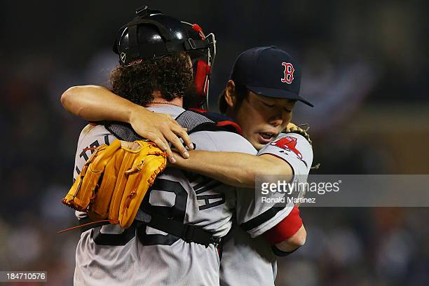 Koji Uehara celebrates with Jarrod Saltalamacchia of the Boston Red Sox after their 1 to 0 win over the Detroit Tigers during Game Three of the...