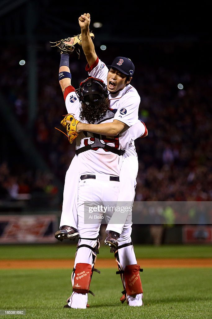 Koji Uehara Jarrod Saltalamacchia of the Boston Red Sox celebrate after defeating the Detroit Tigers in Game Six of the American League Championship...