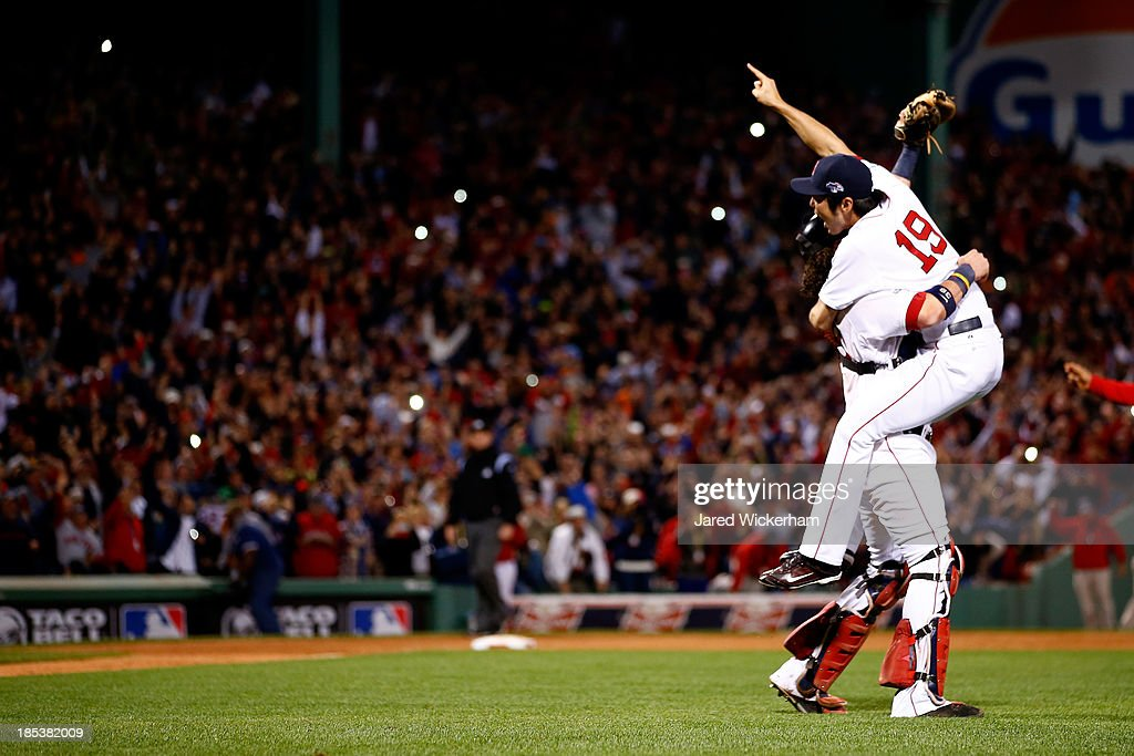 Koji Uehara #19and Jarrod Saltalamacchia #39 of the Boston Red Sox celebrate after defeating the Detroit Tigers in Game Six of the American League Championship Series at Fenway Park on October 19, 2013 in Boston, Massachusetts. The Red Sox defeated the Tigers 5-2 to clinch the ALCS in six games.