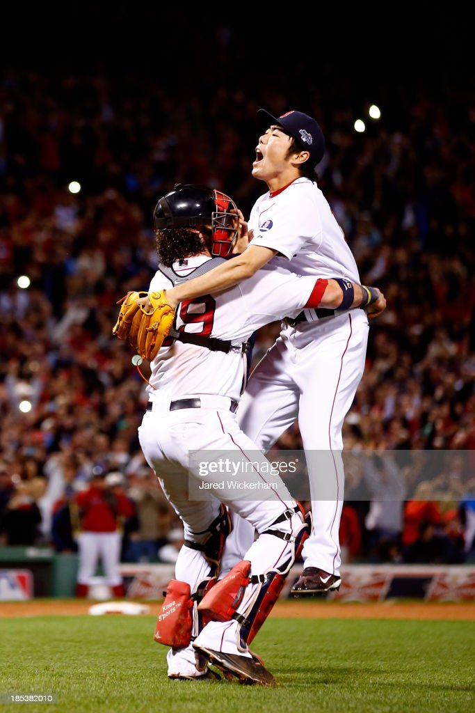 <a gi-track='captionPersonalityLinkClicked' href=/galleries/search?phrase=Koji+Uehara&family=editorial&specificpeople=801278 ng-click='$event.stopPropagation()'>Koji Uehara</a> #19and <a gi-track='captionPersonalityLinkClicked' href=/galleries/search?phrase=Jarrod+Saltalamacchia&family=editorial&specificpeople=836404 ng-click='$event.stopPropagation()'>Jarrod Saltalamacchia</a> #39 of the Boston Red Sox celebrate after defeating the Detroit Tigers in Game Six of the American League Championship Series at Fenway Park on October 19, 2013 in Boston, Massachusetts. The Red Sox defeated the Tigers 5-2 to clinch the ALCS in six games.