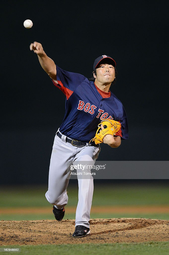 Koji Uehara #19 of Boston Red Sox throws during the spring training game against Baltimore Orioles at Ed Smith Stadium on February 27, 2013 in Sarasota, Florida.