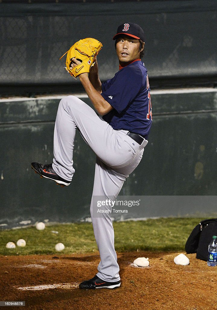 Koji Uehara #19 of Boston Red Sox throws in the bullpen during the spring training game against Baltimore Orioles at Ed Smith Stadium on February 27, 2013 in Sarasota, Florida.