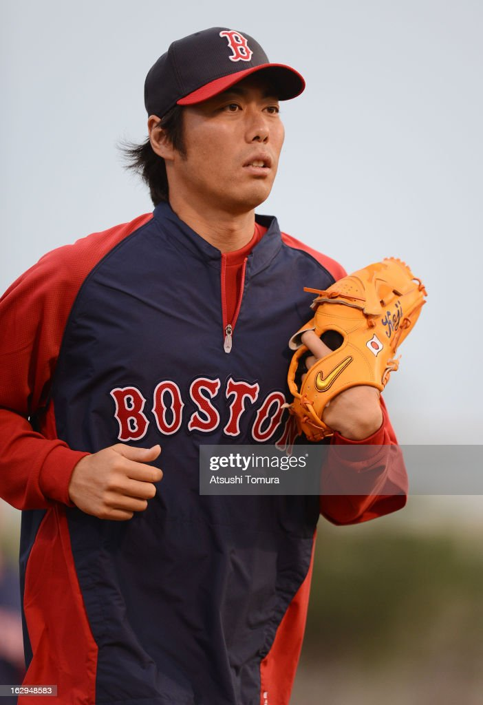 Koji Uehara #19 of Boston Red Sox warms up prior to the spring training game against Baltimore Orioles at Ed Smith Stadium on February 27, 2013 in Sarasota, Florida.