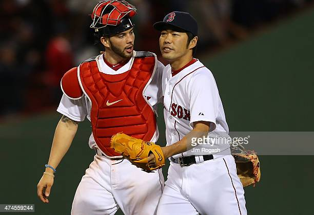 Koji Uehara of the Boston Red Sox and Blake Swihart react after Uehara threw a scoreless ninth inning against the Los Angeles Angels to give the Red...