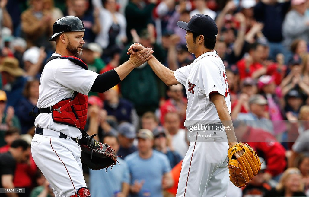 <a gi-track='captionPersonalityLinkClicked' href=/galleries/search?phrase=Koji+Uehara&family=editorial&specificpeople=801278 ng-click='$event.stopPropagation()'>Koji Uehara</a> #19 of the Boston Red Sox and <a gi-track='captionPersonalityLinkClicked' href=/galleries/search?phrase=David+Ross+-+Baseball+Player&family=editorial&specificpeople=210843 ng-click='$event.stopPropagation()'>David Ross</a> #3 of the Boston Red Sox celebrate their 6-3 win over Oakland Athletics, at Fenway Park on May 3, 2014 in Boston, Massachusetts.