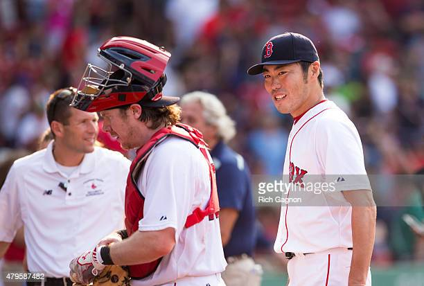 Koji Uehara of the Boston Red Sox celebrates a victory with his teammates against the Houston Astros at Fenway Park on July 5 2015 in Boston...