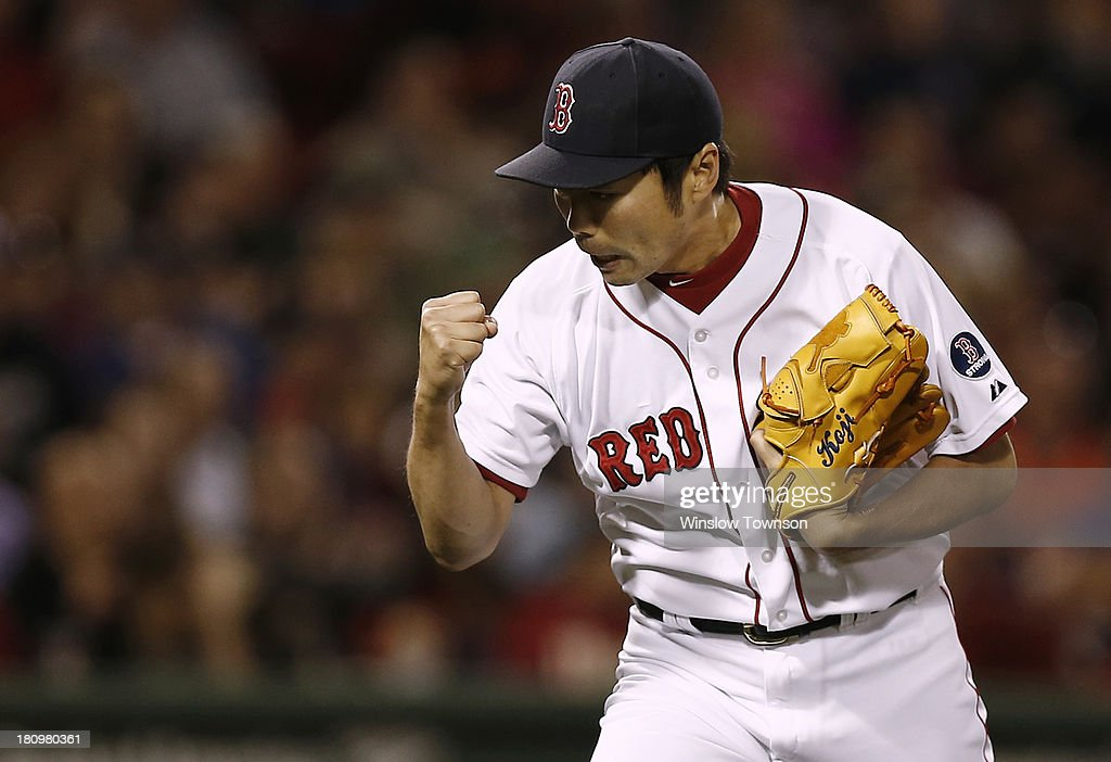 <a gi-track='captionPersonalityLinkClicked' href=/galleries/search?phrase=Koji+Uehara&family=editorial&specificpeople=801278 ng-click='$event.stopPropagation()'>Koji Uehara</a> #19 of the Boston Red Sox celebrates after the last out of the tenth inning of the game against the Baltimore Orioles at Fenway Park on September 18, 2013 in Boston, Massachusetts.