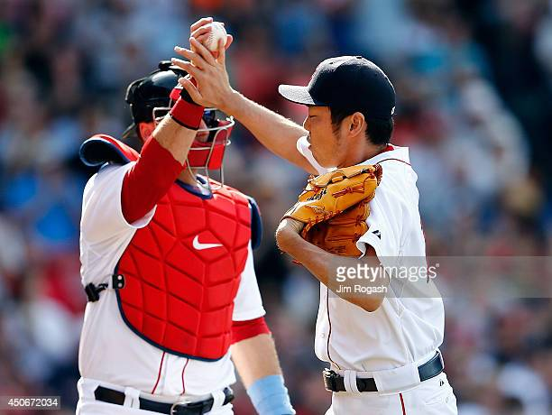 Koji Uehara of the Boston Red Sox celebrates his scoreless ninth inning with AJ Pierzynski against the Cleveland Indians at Fenway Park on June 15...
