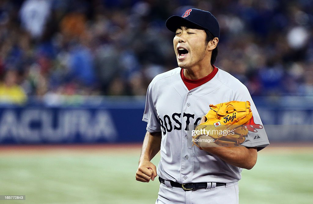 <a gi-track='captionPersonalityLinkClicked' href=/galleries/search?phrase=Koji+Uehara&family=editorial&specificpeople=801278 ng-click='$event.stopPropagation()'>Koji Uehara</a> #19 of the Boston Red Sox celebrates the third out in the 6th inning against the Toronto Blue Jays during MLB action at the Rogers Centre April 5, 2013 in Toronto, Ontario, Canada.
