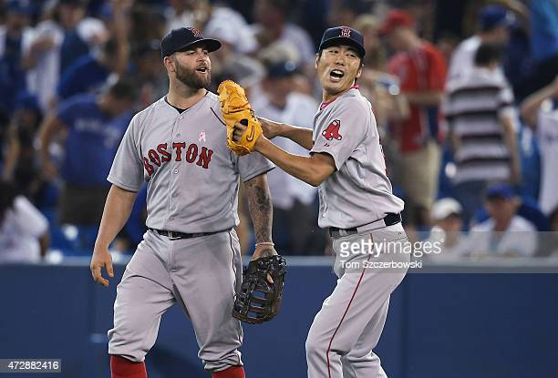 Koji Uehara of the Boston Red Sox celebrates their victory with Mike Napoli during MLB game action against the Toronto Blue Jays on May 10 2015 at...