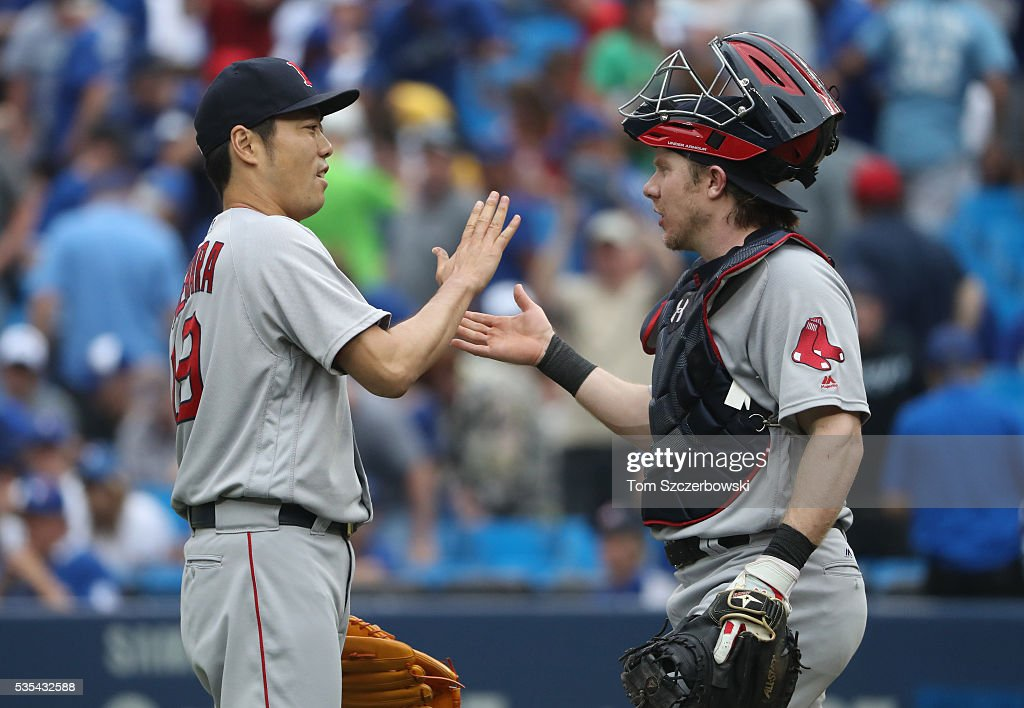 <a gi-track='captionPersonalityLinkClicked' href=/galleries/search?phrase=Koji+Uehara&family=editorial&specificpeople=801278 ng-click='$event.stopPropagation()'>Koji Uehara</a> #19 of the Boston Red Sox celebrates their victory with <a gi-track='captionPersonalityLinkClicked' href=/galleries/search?phrase=Ryan+Hanigan&family=editorial&specificpeople=833982 ng-click='$event.stopPropagation()'>Ryan Hanigan</a> #10 during MLB game action against the Toronto Blue Jays on May 29, 2016 at Rogers Centre in Toronto, Ontario, Canada.
