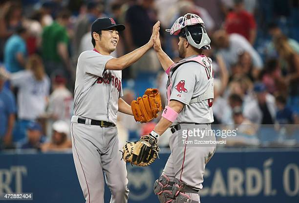 Koji Uehara of the Boston Red Sox celebrates their victory with Sandy Leon during MLB game action against the Toronto Blue Jays on May 10 2015 at...