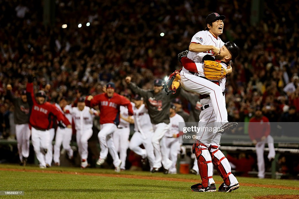 <a gi-track='captionPersonalityLinkClicked' href=/galleries/search?phrase=Koji+Uehara&family=editorial&specificpeople=801278 ng-click='$event.stopPropagation()'>Koji Uehara</a> #19 of the Boston Red Sox celebrates with <a gi-track='captionPersonalityLinkClicked' href=/galleries/search?phrase=David+Ross+-+Baseball+Player&family=editorial&specificpeople=210843 ng-click='$event.stopPropagation()'>David Ross</a> #3 after defeating the St. Louis Cardinals 6-1 in Game Six of the 2013 World Series at Fenway Park on October 30, 2013 in Boston, Massachusetts.