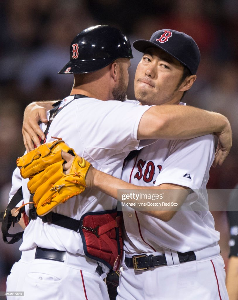 <a gi-track='captionPersonalityLinkClicked' href=/galleries/search?phrase=Koji+Uehara&family=editorial&specificpeople=801278 ng-click='$event.stopPropagation()'>Koji Uehara</a> #19 of the Boston Red Sox celebrates with <a gi-track='captionPersonalityLinkClicked' href=/galleries/search?phrase=David+Ross+-+Baseball+Player&family=editorial&specificpeople=210843 ng-click='$event.stopPropagation()'>David Ross</a> #3 after pitching the final out of a 5-2 victory against the Cleveland Indians in the ninth inning at Fenway Park on June 12, 2014 in Boston, Massachusetts.