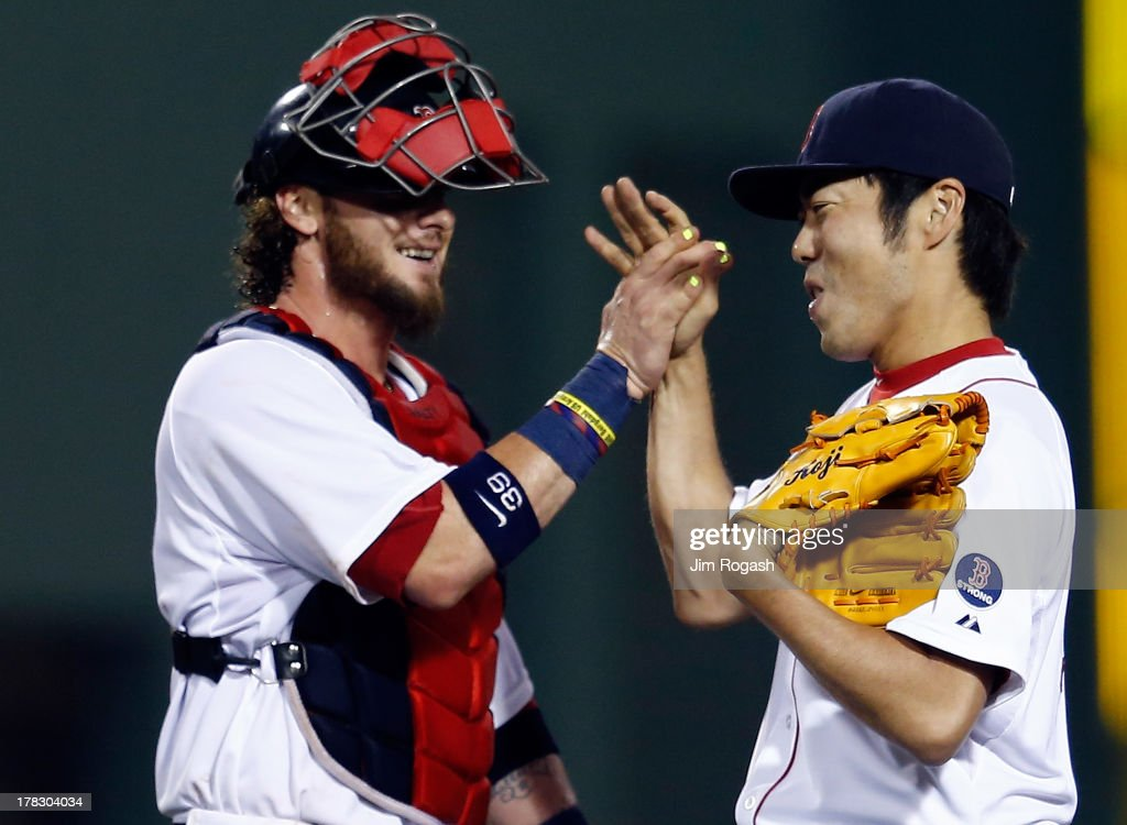 <a gi-track='captionPersonalityLinkClicked' href=/galleries/search?phrase=Koji+Uehara&family=editorial&specificpeople=801278 ng-click='$event.stopPropagation()'>Koji Uehara</a> #19 of the Boston Red Sox celebrates with <a gi-track='captionPersonalityLinkClicked' href=/galleries/search?phrase=Jarrod+Saltalamacchia&family=editorial&specificpeople=836404 ng-click='$event.stopPropagation()'>Jarrod Saltalamacchia</a> #39 of the Boston Red Sox after he earned a save in a 4-3 win against the Baltimore Orioles at Fenway Park on August 28, 2013 in Boston, Massachusetts. The Red Sox won 4-3.