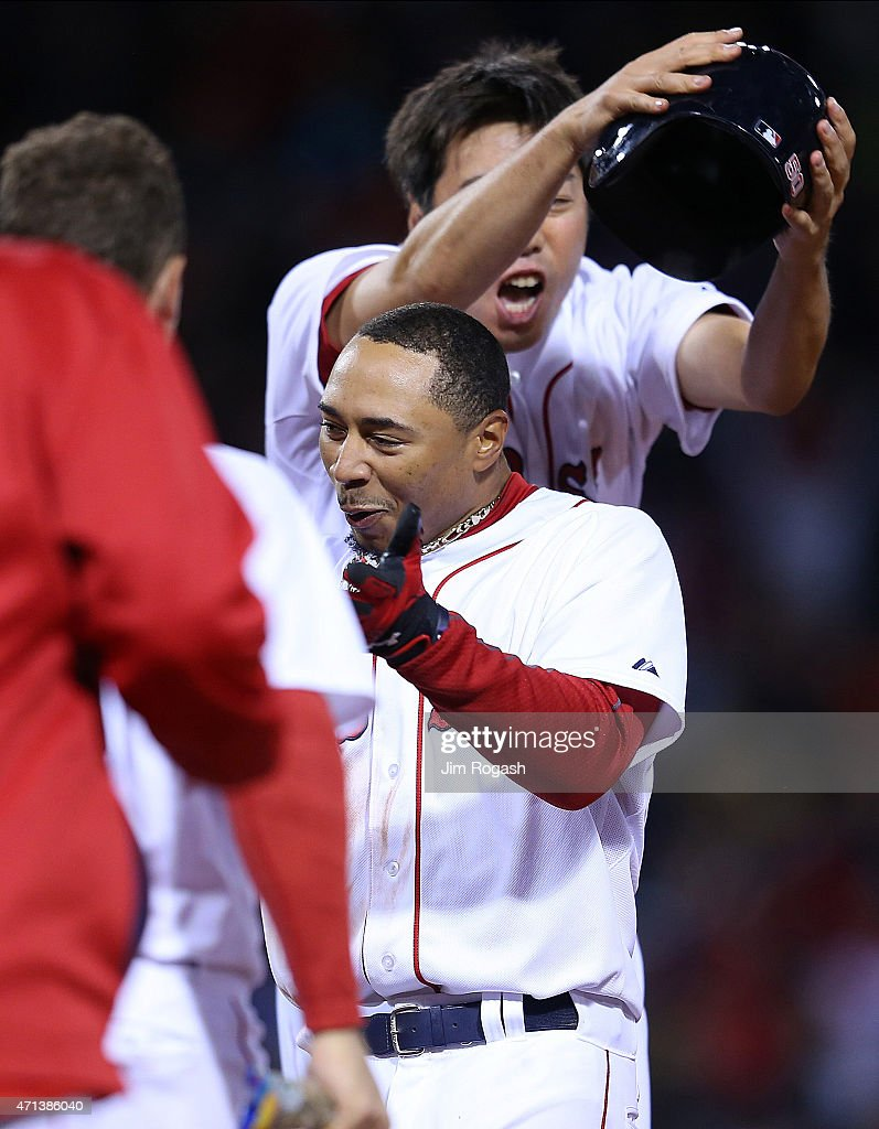 Koji Uehara #19 of the Boston Red Sox celebrates with Mookie Betts #50 after Betts singled in the winning run in the ninth inning against the Toronto Blue Jays at Fenway Park April 27, 2015 in Boston, Massachusetts.