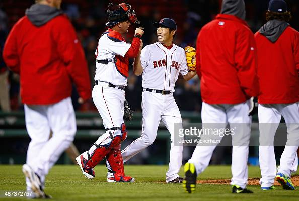 Koji Uehara of the Boston Red Sox celebrates with teammate AJ Pierzynski following their win against the Tampa Bay Rays in the 9th inning during the...