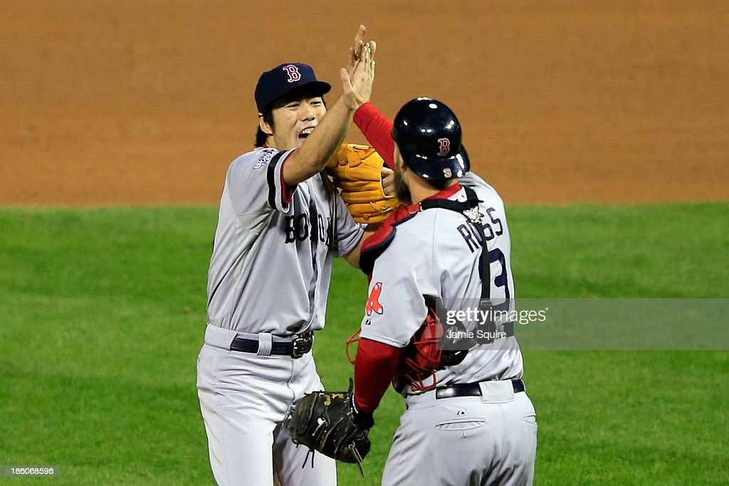 <a gi-track='captionPersonalityLinkClicked' href=/galleries/search?phrase=Koji+Uehara&family=editorial&specificpeople=801278 ng-click='$event.stopPropagation()'>Koji Uehara</a> #19 of the Boston Red Sox celebrates with teammate <a gi-track='captionPersonalityLinkClicked' href=/galleries/search?phrase=David+Ross+-+Baseball+Player&family=editorial&specificpeople=210843 ng-click='$event.stopPropagation()'>David Ross</a> #3 after throwing out Kolten Wong #16 of the St. Louis Cardinals to win Game Four of the 2013 World Series at Busch Stadium on October 27, 2013 in St Louis, Missouri. The Red Sox defeated the Cardinals 4-2.