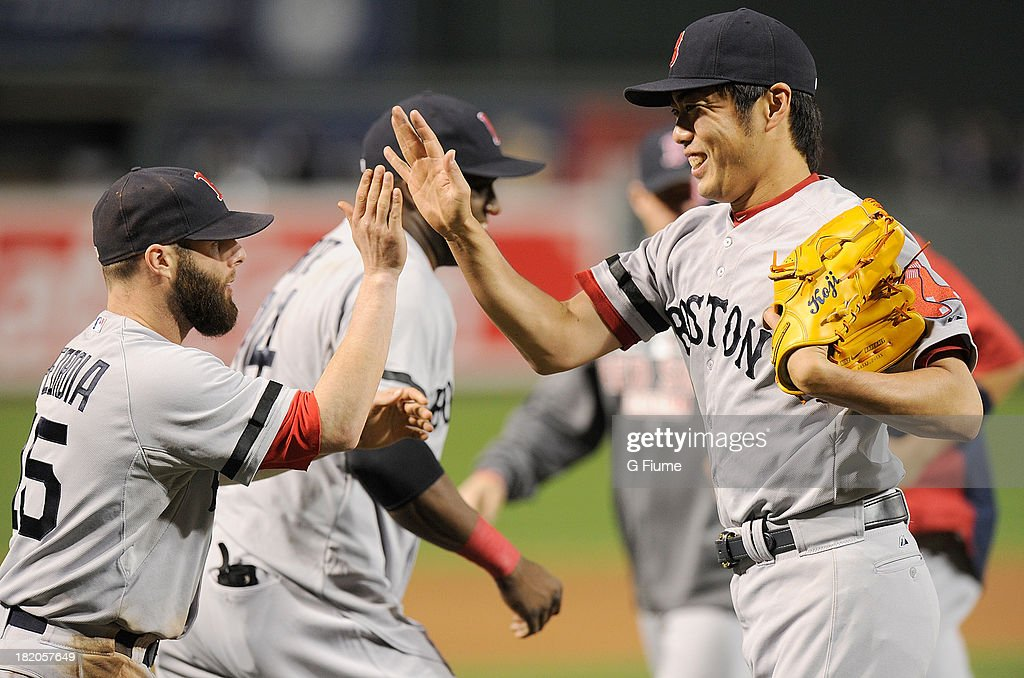 <a gi-track='captionPersonalityLinkClicked' href=/galleries/search?phrase=Koji+Uehara&family=editorial&specificpeople=801278 ng-click='$event.stopPropagation()'>Koji Uehara</a> #19 of the Boston Red Sox celebrates with teammate <a gi-track='captionPersonalityLinkClicked' href=/galleries/search?phrase=Dustin+Pedroia&family=editorial&specificpeople=836339 ng-click='$event.stopPropagation()'>Dustin Pedroia</a> #15 after a 12-3 victory against the Baltimore Orioles at Oriole Park at Camden Yards on September 27, 2013 in Baltimore, Maryland.