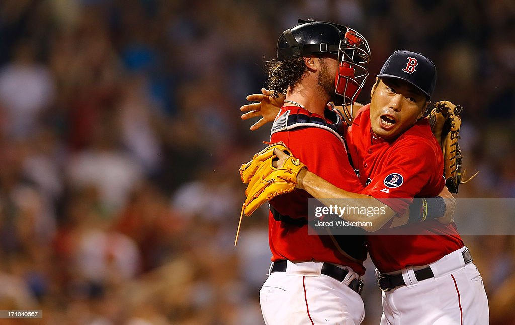 Koji Uehara #19 of the Boston Red Sox celebrates with teammate Jarrod Saltalamacchia #39 after closing out the 9th inning against the New York Yankees during the game on July 19, 2013 at Fenway Park in Boston, Massachusetts.