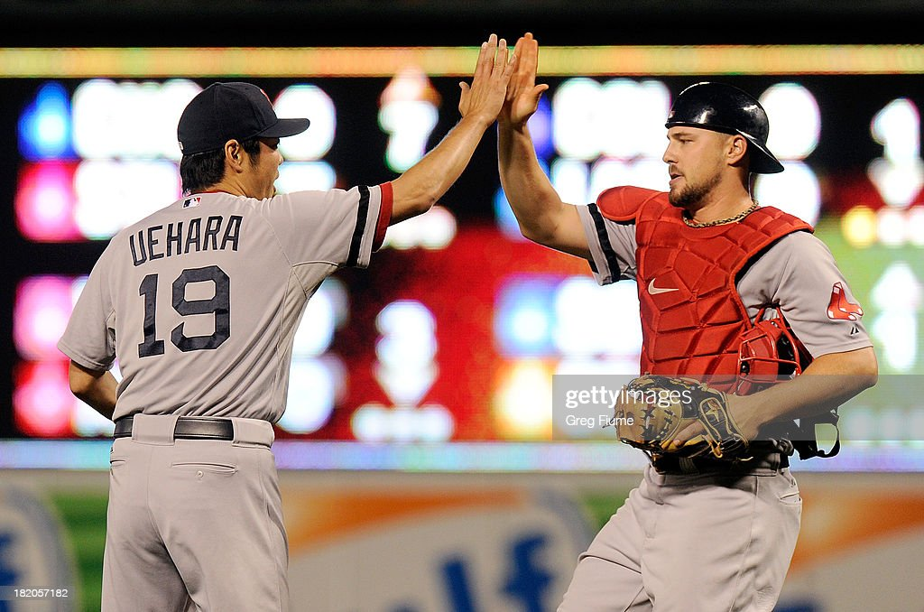 <a gi-track='captionPersonalityLinkClicked' href=/galleries/search?phrase=Koji+Uehara&family=editorial&specificpeople=801278 ng-click='$event.stopPropagation()'>Koji Uehara</a> #19 of the Boston Red Sox celebrates with teammate Ryan Lavarnway #20 after a 12-3 victory against the Baltimore Orioles at Oriole Park at Camden Yards on September 27, 2013 in Baltimore, Maryland.