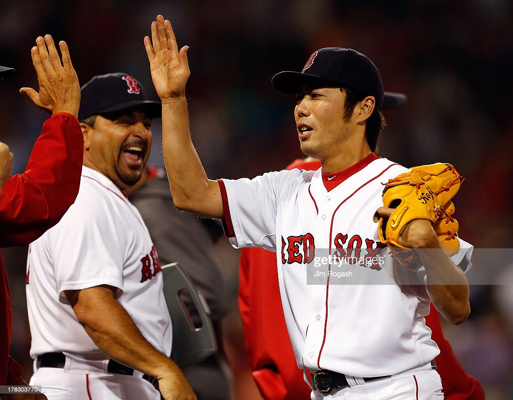 <a gi-track='captionPersonalityLinkClicked' href=/galleries/search?phrase=Koji+Uehara&family=editorial&specificpeople=801278 ng-click='$event.stopPropagation()'>Koji Uehara</a> #19 of the Boston Red Sox celebrates with teammates after he earned a save in a 4-3 win against the Baltimore Orioles at Fenway Park on August 28, 2013 in Boston, Massachusetts. The Red Sox won 4-3.
