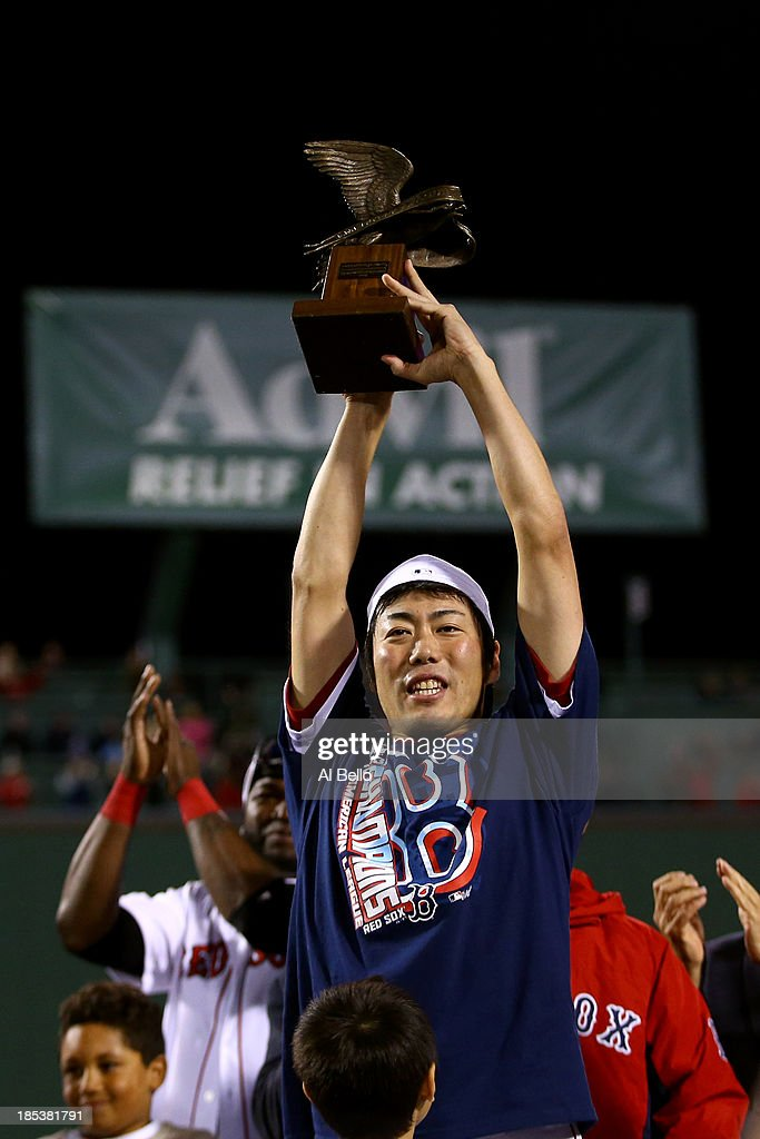 <a gi-track='captionPersonalityLinkClicked' href=/galleries/search?phrase=Koji+Uehara&family=editorial&specificpeople=801278 ng-click='$event.stopPropagation()'>Koji Uehara</a> #19 of the Boston Red Sox celebrates with the trophy after defeating the Detroit Tigers in Game Six of the American League Championship Series at Fenway Park on October 19, 2013 in Boston, Massachusetts. The Red Sox defeated the Tigers 5-2 to clinch the ALCS in six games.