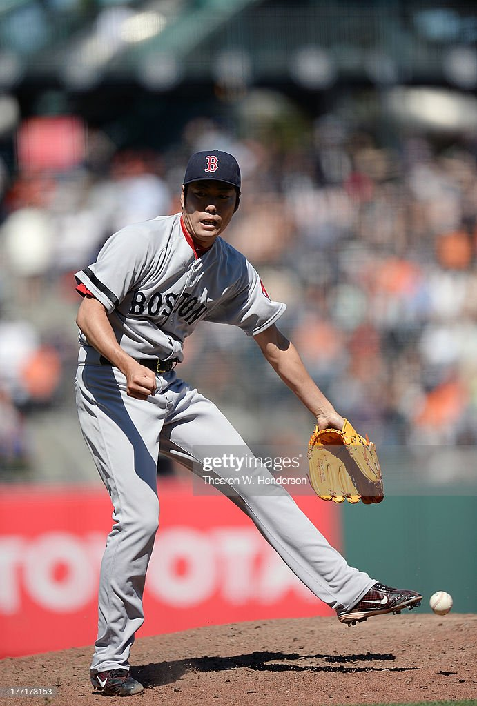 <a gi-track='captionPersonalityLinkClicked' href=/galleries/search?phrase=Koji+Uehara&family=editorial&specificpeople=801278 ng-click='$event.stopPropagation()'>Koji Uehara</a> #19 of the Boston Red Sox deflects the ball off his glove hit by Marco Scutaro #19 of the San Francisco Giants in the ninth inning at AT&T Park on August 21, 2013 in San Francisco, California. The ball went to second baseman Dustin Pedroia #15 who threw Scutaro out at first base.