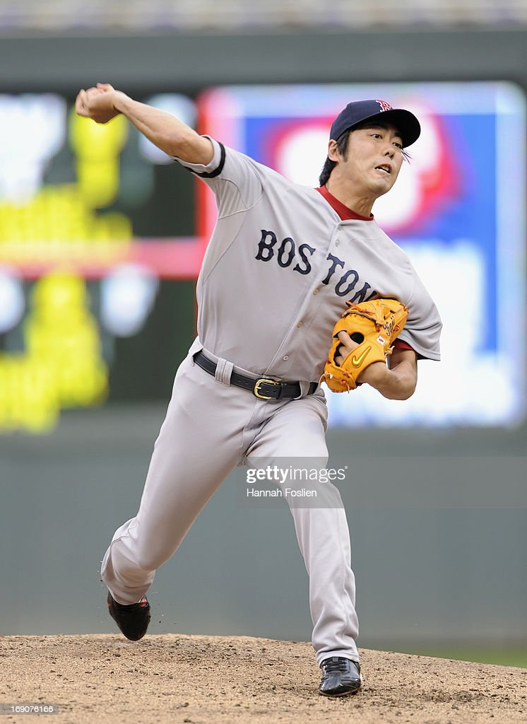 <a gi-track='captionPersonalityLinkClicked' href=/galleries/search?phrase=Koji+Uehara&family=editorial&specificpeople=801278 ng-click='$event.stopPropagation()'>Koji Uehara</a> #19 of the Boston Red Sox delivers a pitch against the Minnesota Twins during the eighth inning of the game on May 19, 2013 at Target Field in Minneapolis, Minnesota.