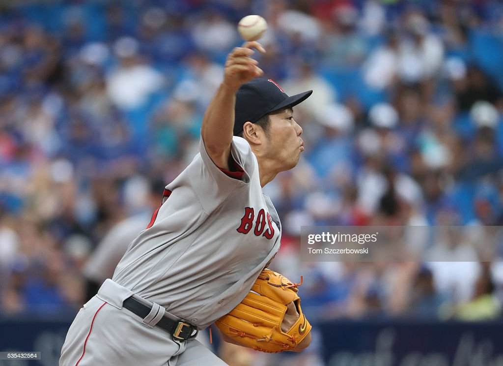 <a gi-track='captionPersonalityLinkClicked' href=/galleries/search?phrase=Koji+Uehara&family=editorial&specificpeople=801278 ng-click='$event.stopPropagation()'>Koji Uehara</a> #19 of the Boston Red Sox delivers a pitch in the eleventh inning during MLB game action against the Toronto Blue Jays on May 29, 2016 at Rogers Centre in Toronto, Ontario, Canada.