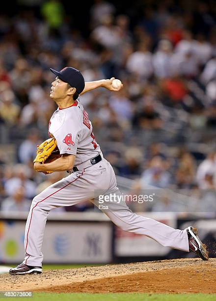 Koji Uehara of the Boston Red Sox delivers a pitch in the ninth inning against the New York Yankees on August 5 2015 at Yankee Stadium in the Bronx...