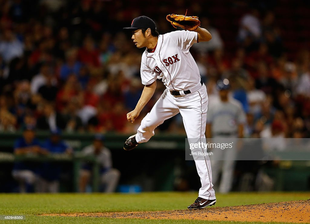 <a gi-track='captionPersonalityLinkClicked' href=/galleries/search?phrase=Koji+Uehara&family=editorial&specificpeople=801278 ng-click='$event.stopPropagation()'>Koji Uehara</a> #19 of the Boston Red Sox follows through on a pitch in the ninth inning against the Toronto Blue Jays at Fenway Park on July 30, 2014 in Boston, Massachusetts.
