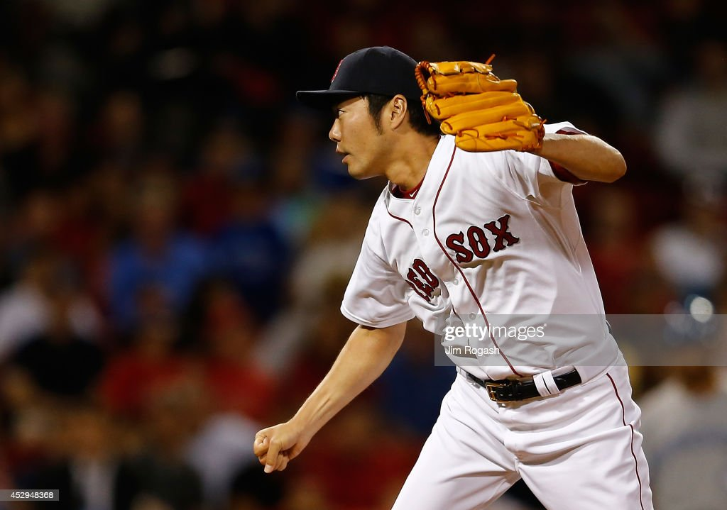 Koji Uehara #19 of the Boston Red Sox follows through on a pitch in the ninth inning against the Toronto Blue Jays at Fenway Park on July 30, 2014 in Boston, Massachusetts.