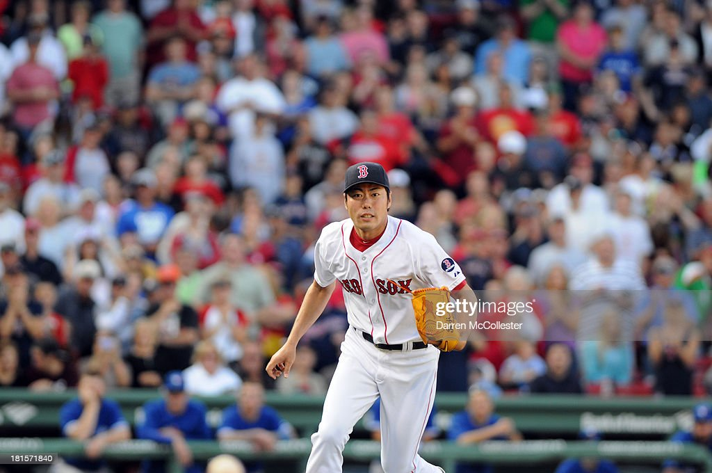 <a gi-track='captionPersonalityLinkClicked' href=/galleries/search?phrase=Koji+Uehara&family=editorial&specificpeople=801278 ng-click='$event.stopPropagation()'>Koji Uehara</a> #19 of the Boston Red Sox heads to first base to field the final out in the ninth inning against the Toronto Blue Jays at Fenway Park on September 22, 2013 in Boston, Massachusetts. The Red Sox won the game 5-2