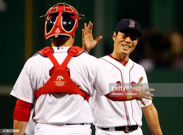 Koji Uehara of the Boston Red Sox is congratulated by Sandy Leon of the Boston Red Sox after the Red Sox 51 win over the Baltimore Orioles in a game...