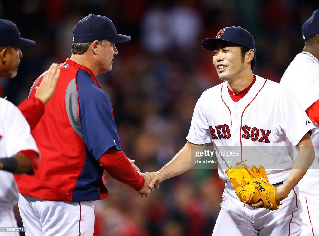 <a gi-track='captionPersonalityLinkClicked' href=/galleries/search?phrase=Koji+Uehara&family=editorial&specificpeople=801278 ng-click='$event.stopPropagation()'>Koji Uehara</a> #19 of the Boston Red Sox is congratulated on the 4-3 win by manager <a gi-track='captionPersonalityLinkClicked' href=/galleries/search?phrase=John+Farrell+-+Baseball+Manager&family=editorial&specificpeople=10307520 ng-click='$event.stopPropagation()'>John Farrell</a> #53 against the Cincinnati Reds in the 9th inning during the interleague game at Fenway Park on May 7, 2014 in Boston, Massachusetts.