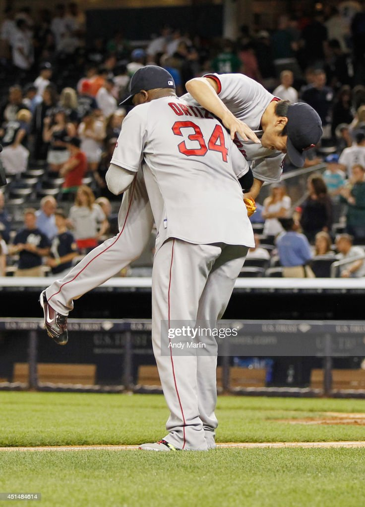 Koji Uehara #19 of the Boston Red Sox is picked up by David Ortiz #34 after the Red Sox defeated the New York Yankees at Yankee Stadium on June 29, 2014 in the Bronx borough of New York City. The Red Sox defeated the Yankees 8-5.
