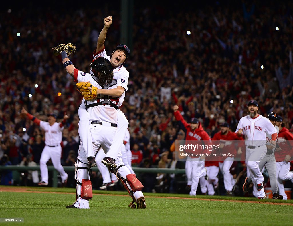 Koji Uehara #19 of the Boston Red Sox jumps into the arms of Jarrod Saltalamacchia #39 after defeating the Detroit Tigers in Game Six of the American League Championship Series on October 19, 2013 at Fenway Park in Boston, Massachusetts.