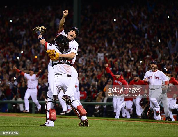 Koji Uehara of the Boston Red Sox jumps into the arms of Jarrod Saltalamacchia after defeating the Detroit Tigers in Game Six of the American League...
