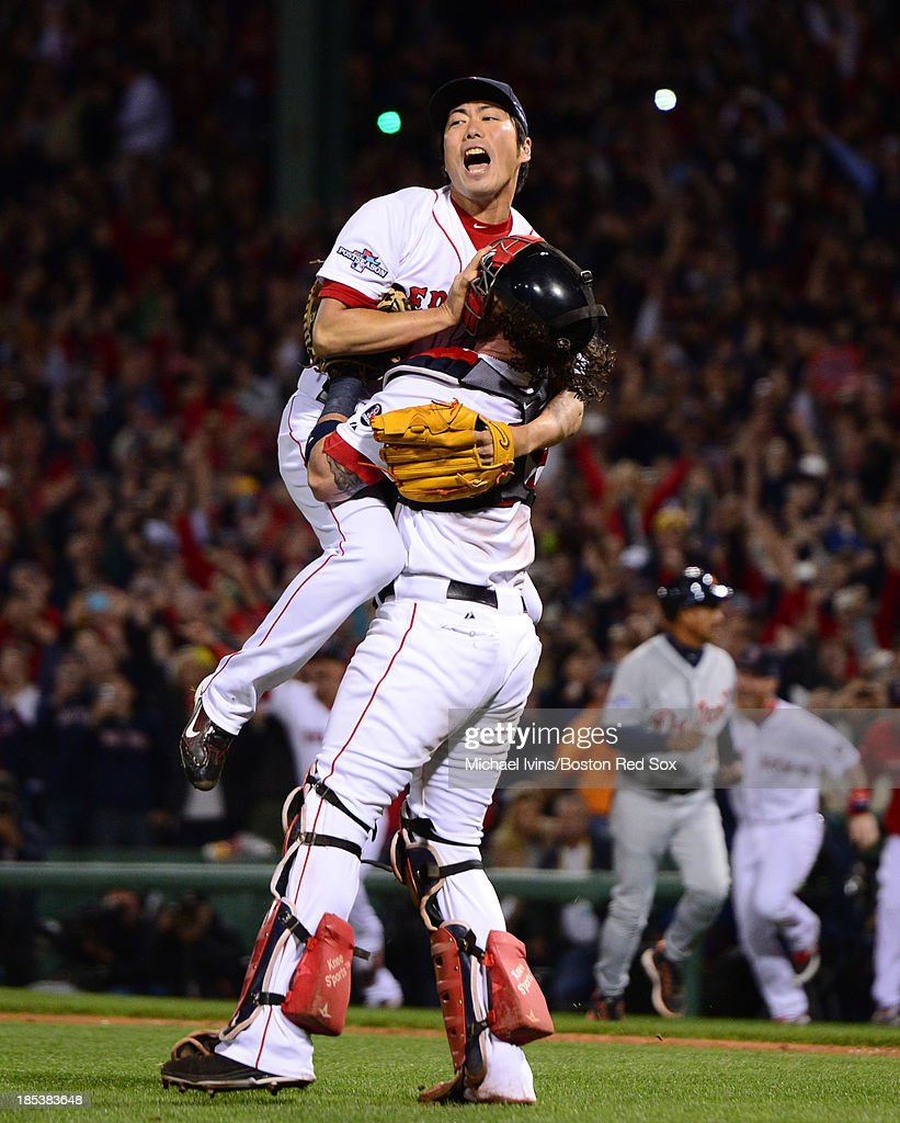 <a gi-track='captionPersonalityLinkClicked' href=/galleries/search?phrase=Koji+Uehara&family=editorial&specificpeople=801278 ng-click='$event.stopPropagation()'>Koji Uehara</a> #19 of the Boston Red Sox jumps into the arms of <a gi-track='captionPersonalityLinkClicked' href=/galleries/search?phrase=Jarrod+Saltalamacchia&family=editorial&specificpeople=836404 ng-click='$event.stopPropagation()'>Jarrod Saltalamacchia</a> #39 after defeating the Detroit Tigers in Game Six of the American League Championship Series on October 19, 2013 at Fenway Park in Boston, Massachusetts.