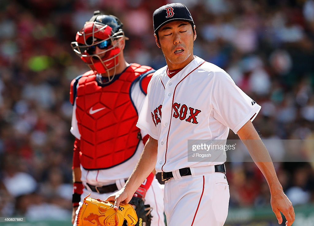 Koji Uehara #19 of the Boston Red Sox leaves after pitching the tenth inning against the Minnesota Twins at Fenway Park on June 18, 2014 in Boston, Massachusetts.