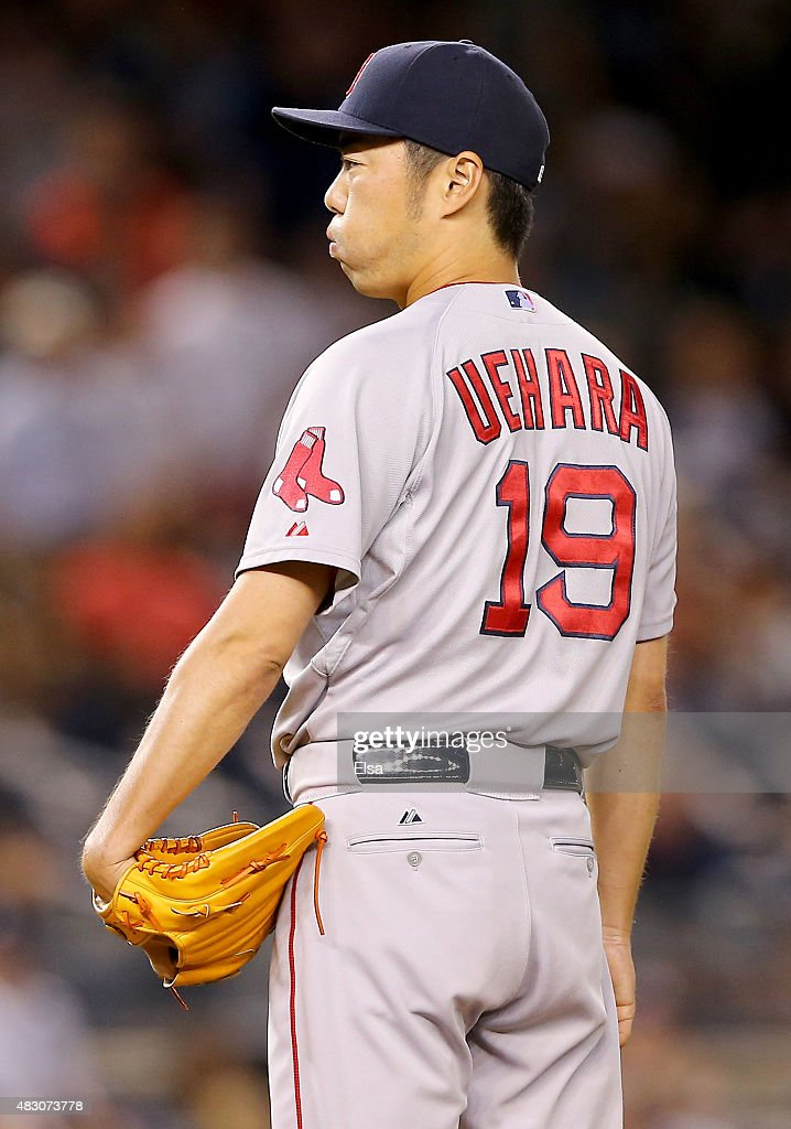 Koji Uehara #19 of the Boston Red Sox looks for the sign in the ninth inning against the New York Yankees on August 5, 2015 at Yankee Stadium in the Bronx borough of New York City.The Boston Red Sox defeated the New York Yankees 2-1.
