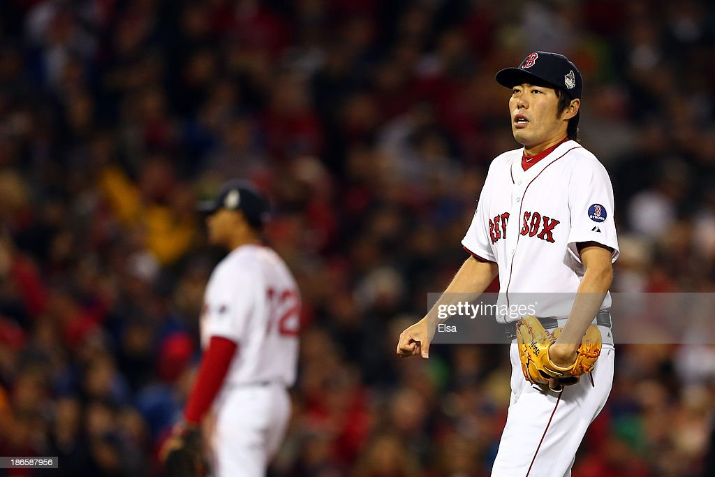 Koji Uehara #19 of the Boston Red Sox looks on in the ninth inning against the St. Louis Cardinals during Game Six of the 2013 World Series at Fenway Park on October 30, 2013 in Boston, Massachusetts.