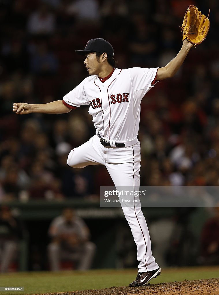 <a gi-track='captionPersonalityLinkClicked' href=/galleries/search?phrase=Koji+Uehara&family=editorial&specificpeople=801278 ng-click='$event.stopPropagation()'>Koji Uehara</a> #19 of the Boston Red Sox pitches against the Baltimore Orioles during the tenth inning of the game at Fenway Park on September 18, 2013 in Boston, Massachusetts.