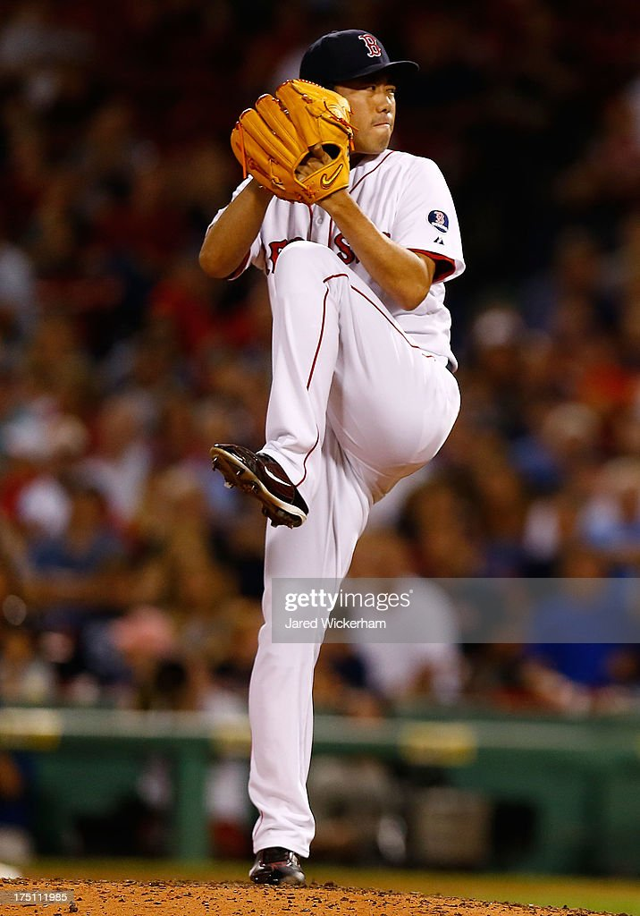 <a gi-track='captionPersonalityLinkClicked' href=/galleries/search?phrase=Koji+Uehara&family=editorial&specificpeople=801278 ng-click='$event.stopPropagation()'>Koji Uehara</a> #19 of the Boston Red Sox pitches against the Seattle Mariners during the game on July 31, 2013 at Fenway Park in Boston, Massachusetts.