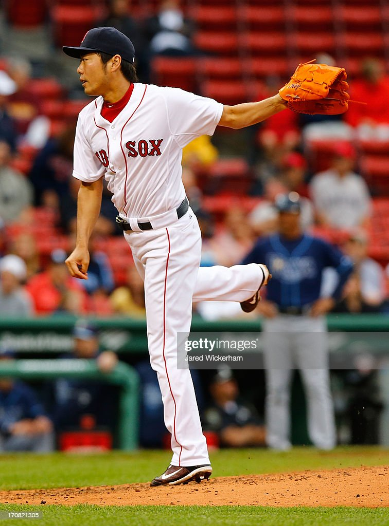 Koji Uehara #19 of the Boston Red Sox pitches against the Tampa Bay Rays during the game on June 18, 2013 at Fenway Park in Boston, Massachusetts.