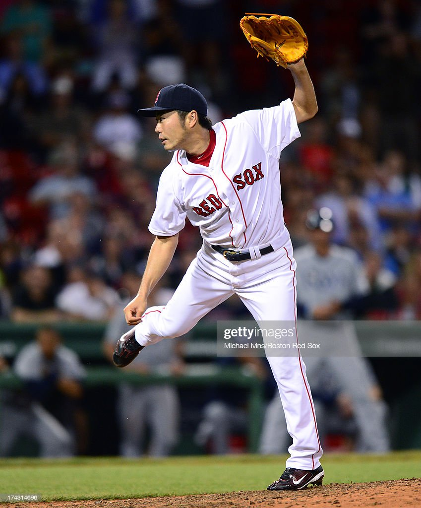 <a gi-track='captionPersonalityLinkClicked' href=/galleries/search?phrase=Koji+Uehara&family=editorial&specificpeople=801278 ng-click='$event.stopPropagation()'>Koji Uehara</a> #19 of the Boston Red Sox pitches against the Tampa Bay Rays in the ninth inning on July 23, 2013 at Fenway Park in Boston, Massachusetts.