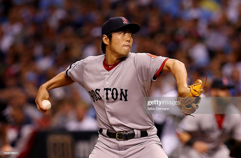 Koji Uehara #19 of the Boston Red Sox pitches against the Tampa Bay Rays in the eighth inning during Game Four of the American League Division Series at Tropicana Field on October 8, 2013 in St Petersburg, Florida.
